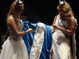 Taylor and Sabrina pointing to their names on the Ambassador robe
