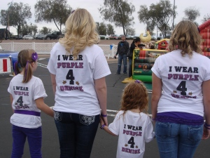 Taylor, Sydnee, Gracie and Sabrina wearing their shirts for Denise at the BBQ Cookoff