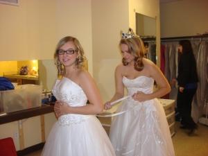 Kirsten helping Taylor tie her dress