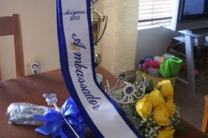 Robyn's Ambassador crown, scepter, flowers, and trophy